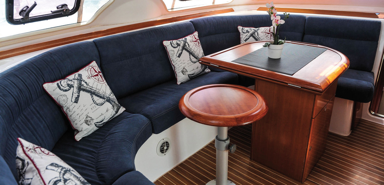The cockpit, sheltered from the sun and the bad weather, offers a huge relaxation area, which incorporates a table and some long settees.