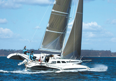 The cruising multihulls match: Two or three hulls?